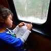 KRISTOPHER RADDER — BRATTLEBORO REFORMER<br /> Gracie Patterson, 8, colors a picture of Santa while siting next to a window.
