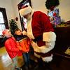 KRISTOPHER RADDER — BRATTLEBORO REFORMER<br /> Emerson Judd, 4, and Brooke Harrison, 5, look up at Santa.