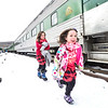 KRISTOPHER RADDER — BRATTLEBORO REFORMER<br /> Clara, 5, and Ava Buchholz, 7, runs to board the Santa Express at the Bellows Falls train station on Sunday, Nov. 18, 2018.