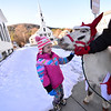 "KRISTOPHER RADDER — BRATTLEBORO REFORMER<br /> Kali Overman, 4, pets the miniature horse ""Buddy,"" from Brookline West River Stables, during the start of Winterfest, in Newfane, on Sunday, Dec. 9, 2018."