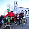 KRISTOPHER RADDER — BRATTLEBORO REFORMER<br /> Santa Claus waves to a group of people wating to meet him at Union Hall, in Newfane, during the Winterfest on Sunday, Dec. 9, 2018.