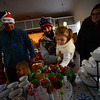 KRISTOPHER RADDER — BRATTLEBORO REFORMER<br /> Chris Shippa holds his 3-year-old daughter Raelyn, as she grabs a cookie pop as they wait for the arrival of Santa Claus on Sunday, Dec. 9, 2018.