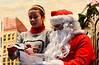 KRISTOPHER RADDER - BRATTLEBORO REFORMER<br /> Ruthie Wright, 11, hands Santa her Christmas list during WinterFest on Sunday, Dec. 11, 2016.