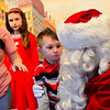 Lucius Hamblin, 4, talks with Santa.