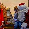 Kol Jillson, 3, sits on Santa's lap.