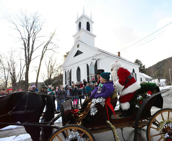Santa waves to those that greet him outside the Newfane Town Hall.