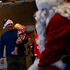 Rich Sunburn holds his one-year-old Persephone Olivari as he brings her to meet Santa.