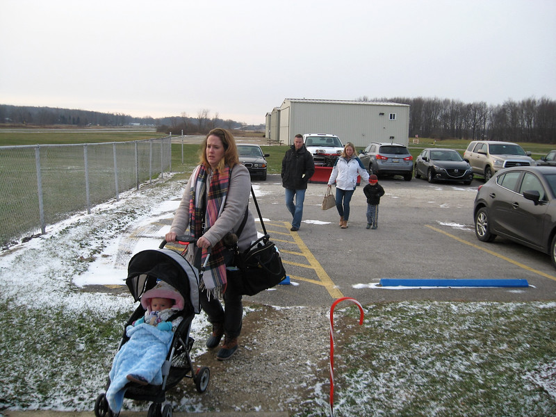 BOB SANDRICK / GAZETTE Parents escorted their children inside the terminal at Wadsworth Municipal Airport on Saturday to see Santa Claus arrive by plane.