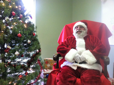 BOB SANDRICK / GAZETTE Santa takes a breather Saturday morning after a long trip from the North Pole to Wadsworth Municipal Airport.