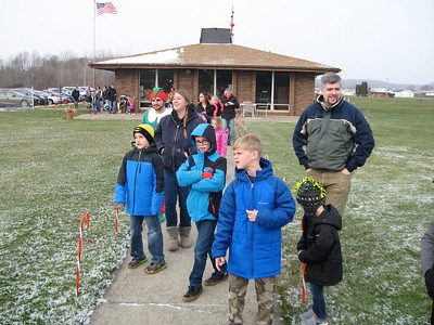 BOB SANDRICK / GAZETTE When the call went out that Santa was arriving Saturday morning at Wadsworth Municipal Airport, everyone bundled up and raced outside.