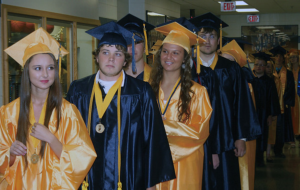 SCOTT WEISSER | The Goshen News<br /> Members of the Fairfield High School Class of 2013 prepare to enter the school gym for their commencement. Soon-to-be graduates pictured include Alaina Dunkin and Marshall Dillon.