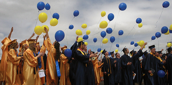 SCOTT WEISSER   The Goshen News<br /> Fairfield High School graduates release blue- and gold-colored balloons outside the school after commencement exercises Sunday afternoon.