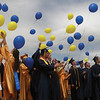 SCOTT WEISSER | The Goshen News<br /> Fairfield High School graduates release blue- and gold-colored balloons outside the school after commencement exercises Sunday afternoon.