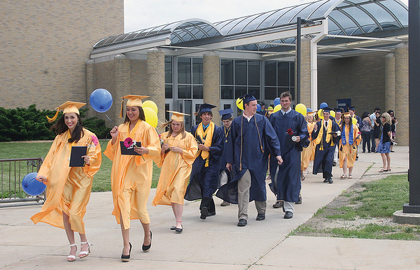 SCOTT WEISSER   The Goshen News<br /> Members of the Fairfield High School Class of 2013 head outside the school to take part in a balloon-launching ceremony Sunday. The young people had just concluded their commencement.