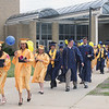 SCOTT WEISSER | The Goshen News<br /> Members of the Fairfield High School Class of 2013 head outside the school to take part in a balloon-launching ceremony Sunday. The young people had just concluded their commencement.