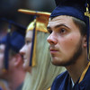 Jared Johnson listens during the commencement ceremony Sunday afternoon at Fairfield High School.