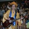 SCOTT WEISSER | The Goshen News<br /> MyKayla Neilson plays acoustic guitar during Sunday's commencemenet at Fairfield. She was accompanying the Senior Choir during a performance.