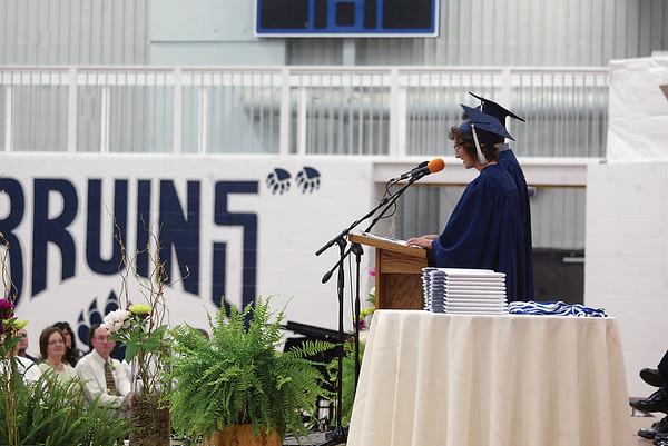 MICHAEL WANBAUGH | THE GOSHEN NEWS<br /> Graduating Bethany Christian seniors Maddie Gerig and Jesse Bontreger, obscured, offer the senior address during graduation ceremonies Sunday inside the school gym.