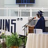 MICHAEL WANBAUGH | THE GOSHEN NEWS<br /> Graduating Bethany Christian seniors Maddie Gerig and Jesse Bontreger, obscured, offer the senior address during graduation ceremonies Sunday inside the school gym.