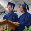 MICHAEL WANBAUGH | THE GOSHEN NEWS<br /> Graduating Bethany Christian seniors Jesse Bontreger, left, and Maddie Gerig, offer the senior address during graduation ceremonies Sunday inside the school gym.