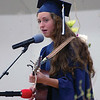 "MICHAEL WANBAUGH | THE GOSHEN NEWS<br /> Bethany Christian High School graduating senior Sadie Gustafson-Zook plays guitar and sings, ""Unless I Loved,"" during the school's commencement ceremony Sunday afternoon in the gym."