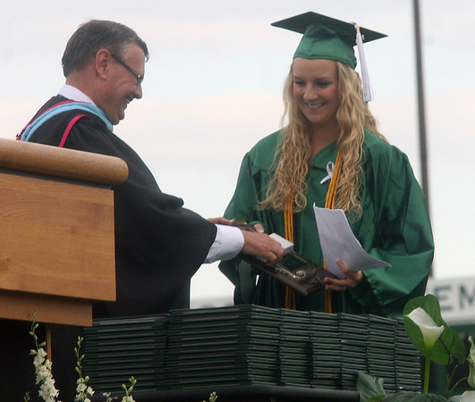 JOHN KLINE | THE GOSHEN NEWS<br /> 2013 Concord High School Valedictorian Hailey Stiver, right, is greeted by Concord High School Principal Dan Cunningham before giving her student address during the high school's graduation ceremony Friday evening.