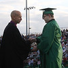 JOHN KLINE | THE GOSHEN NEWS<br /> Concord High School senior Paul Hardison, right, accepts his diploma from Concord School Board member Tim Yoder during the school's graduation ceremony Friday in Elkhart.