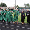 JOHN KLINE | THE GOSHEN NEWS<br /> Concord High School graduating seniors Johnny Bennett, center left, and Miles Barrett, center right, camp it up for the crowd before heading onto the school football field for the 2013 Concord High School Graduation Ceremony Friday.