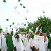 SHEILA SELMAN | THE GOSHEN NEWS<br /> Wawasee High School graduates toss their caps into the air after commencement Saturday, June 8, 2013.