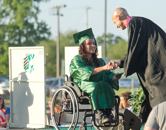 SAM HOUSEHOLDER | THE GOSHEN NEWS<br /> Concord graduate Kaitlyn Kronemeyer receives her diploma Thursday during the school's commencement ceremony. Handing her diploma is school board member Tim Yoder.