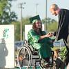 SAM HOUSEHOLDER | THE GOSHEN NEWS<br /> Concord graduate Kaitlyn Kronemeyer receives her diploma Thursday during the school's commencement ceremony. Handing her diploma is school board member Tim Yoder.