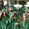 SAM HOUSEHOLDER | THE GOSHEN NEWS<br /> Concord High School graduates shield their eyes for the sun while looking for their family and friends before the start of the commecement ceremony Thursday.
