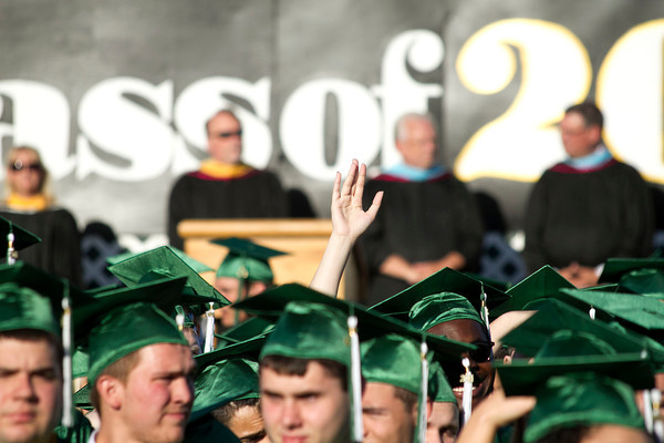 SAM HOUSEHOLDER | THE GOSHEN NEWS<br /> A student waves at the crowd before the start of Concord High School's commencement ceremony Thursday on Jake Field.