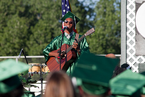 "SAM HOUSEHOLDER | THE GOSHEN NEWS<br /> Roberto Ortiz sings ""Gold"" a song he wrote and arranged himself during the Concord Commencement Ceremony Thursday on Jake Field."