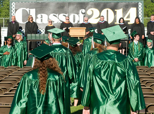 SAM HOUSEHOLDER | THE GOSHEN NEWS<br /> The Concord High School class of 2014 files into their seats on Jake Field ahead of the commencement ceremony Thursday.