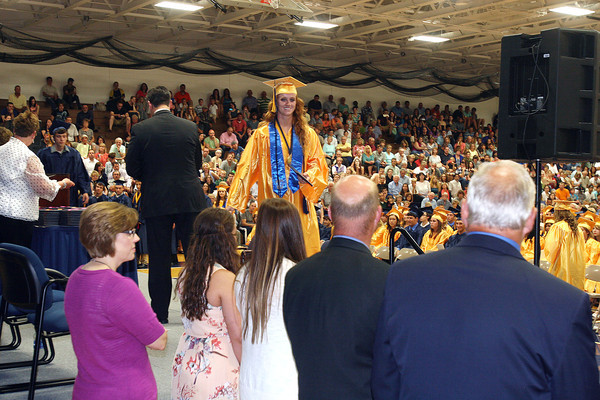 DANIEL RIORDAN | THE GOSHEN NEWS<br /> Haley Brown, one of three salutatorians in Fairfield's class of 2014 leaves the stage after receiving her diploma Sunday.