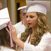 SAM HOUSEHOLDER | THE GOSHEN NEWS<br /> Kalin Meikle adjusts Courtney Blankenbakey's hat ahead of Goshen High School's commencement ceremony Sunday.
