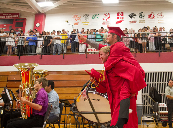 SAM HOUSEHOLDER | THE GOSHEN NEWS<br /> Evan Smith carries Austin Stieglitz into the gymnasium Sunday for the Goshen High School commencement ceremony Sunday.