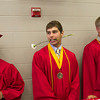 SAM HOUSEHOLDER | THE GOSHEN NEWS<br /> Austin Weirich stands with his flower in his mouth before Goshen High School's commencement ceremony Sunday.