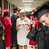SAM HOUSEHOLDER | THE GOSHSEN NEWS<br /> Melanie Ferzida, center, lines up students ahead of the NorthWood High School commencement ceremony Friday.