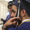 JULIE CROTHERS BEER | THE GOSHEN NEWS<br /> Clinton Christian School graduate Brett Rosas prepares to walk across the stage Friday. Rosas graduated Friday night as part of the seven-member Clinton Christian Class of 2015.