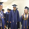 JULIE CROTHERS BEER | THE GOSHEN NEWS<br /> Clinton Christian School graduates, from left, Chandler Beachy, Joshua Horst and Victoria Hathaway share a laugh before walking to the stage in the gymnasium Friday night. The seven-member  Clinton Christian Class of 2015 graduated Friday.