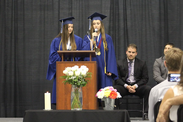 JULIE CROTHERS BEER   THE GOSHEN NEWS<br /> Clinton Christian School salutatorian Tiffany Miller and valedictorian Bethany Mullet share a commencement speech Friday during the graduation celebration Friday at the school.