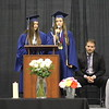 JULIE CROTHERS BEER | THE GOSHEN NEWS<br /> Clinton Christian School salutatorian Tiffany Miller and valedictorian Bethany Mullet share a commencement speech Friday during the graduation celebration Friday at the school.