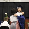 JULIE CROTHERS BEER | THE GOSHEN NEWS<br /> Clinton Christian School and class valedictorian Bethany Mullet hugs her mom, Yvonne Mullet, while presenting her with a rose during Friday's graduation ceremony.