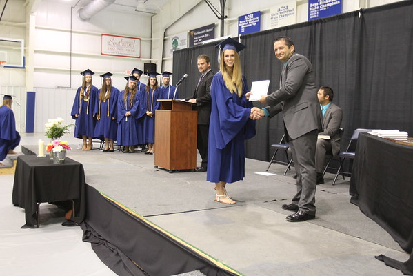 JULIE CROTEHRS BEER | THE GOSHEN NEWS<br /> Clinton Christian School graduate Sadie Yoder receives her diploma during Friday's graduation ceremony at the school.