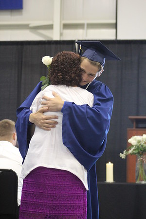 JULIE CROTHERS BEER | THE GOSHEN NEWS<br /> Clinton Christian School graduate Keidrick Miller hugs his mom while presenting her with a rose during Friday's graduation ceremony.