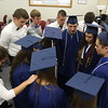JULIE CROTHERS BEER | THE GOSHEN NEWS<br /> Surrounded by the junior class representatives, members of the Clinton Christian School class of 2016 gather Friday for a prayer before the graduation ceremony begins.