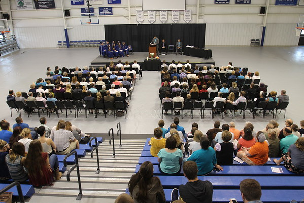 JULIE CROTHERS BEER | THE GOSHEN NEWS<br /> Members of the Clinton Christian School class of 2016 listen during a commencement address Friday during the 49th annual graduation ceremony Friday at the school.