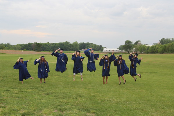 JULIE CROTHERS BEER | THE GOSHEN NEWS<br /> Graduates of the Clinton Christian School class of 2016 jump for joy before Friday's graduation ceremony. From left, Jasmine Yoder, Amber Marshall, Austin Miller, Sadie Yoder, Keidrick Miller, Bethany Mullet, Tiffany Miller and Emily Borkowski.